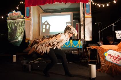 Jen Wilson as the Hawk - performer, costume design, and backdrop artist